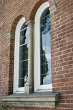 Arched Windows on Old Brick Building stock photo