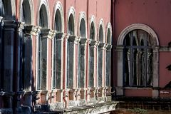 A series of windows reflected on another window. A 19th century neo-renaissance style building `s courtyard with arched windows. royalty free stock photos