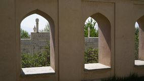 Arched windows at Tomb of Babur in Bagh-e Babur, Kabul, Afghanistan. You can see a view of the Shah Jahan Mosque through the windows. Gardens of Babur, Kabul stock video footage