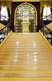Arched Windows and yellow stairs Royalty Free Stock Photography