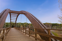 Arched wood bridge in forest Royalty Free Stock Photos