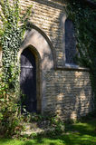 Arched wooden church door in England Royalty Free Stock Image