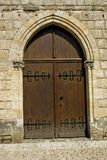 Arched wooden door Stock Image