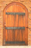 Arched wooden door Stock Photos