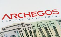 Free ARCHEGOS Capital Management Logo On Paper Background US Dollar Bills Seen In Focus Placed On The Flat Surface With Blurred. Royalty Free Stock Photos - 214931858