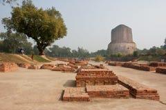 Archeological landmark with ruins of old monastery and Buddhist Dhamek stupa Stock Photos