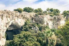 Archeological park, rocks near Greek Theatre of Syracuse, ruins of ancient monument, Sicily, Italy stock images