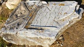 Archeological site-Sarmizegetusa Ulpia Traiana. Roman inscription in Latin on a rock in archeological site Sarmizegetusa Ulpia Traiana stock photography