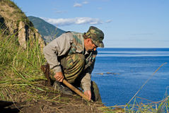 Archeologist 17. The archeologist digs ground at sea. He explores new places for Institute of Archeology and Ethnography (Vladivostok Stock Images