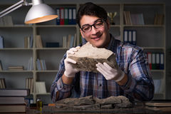 The archeologist working late night in office Royalty Free Stock Photos
