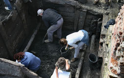 Archeologists at work. A group of archeologists is doing excavation work on building constructions dating back to almost 1000 years ago located at Gdańsk ( Stock Photo