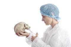 Archeology mature woman with skull Royalty Free Stock Photos
