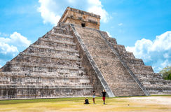 Archeology and nature of the Yukatan peninsula. Chichen Itza , Mexico - April 18, 2016: Archaeological site, tousists under  the imposing Castle  El Castillio Stock Photo
