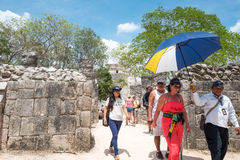 Archeology and nature of the Yukatan peninsula. Chichen Itza , Mexico - April 18, 2016: Tourists in the archaeological site Stock Photos