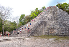 Archeology and nature of the Yukatan peninsula. Coba , Mexico - April 20, 2016: Archaeological site, touists climbing the Nohoch Mul pyramid Stock Photo