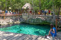 Archeology and nature of the Yukatan peninsula. Coba , Mexico - April 20, 2016: Tourists bathing in the sinkhole of the archaeological site Stock Photos