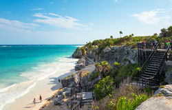 Archeology and nature of the Yukatan peninsula. Tulum, Mexico - April 20, 2016:  Sea view from the Mayan city archaeological site with many tourists Stock Image