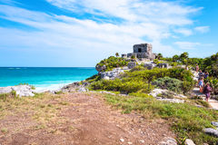 Archeology and nature of the Yukatan peninsula. Tulum, Mexico - April 20, 2016:  Sea view from the Mayan city archaeological site, with tourists on the right Royalty Free Stock Images