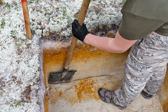 Archeology: rough cleaning of the excavation wall Royalty Free Stock Photo