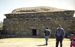 Archeology visitors. Local like to visit their own archeological site. Here, houses from 13th century, Peru Indian culture Stock Images