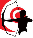 Archer against a bulls eye Stock Images