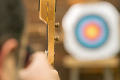 Archer aiming against the blurred target. Stock Images