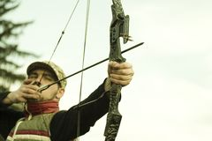Archer aiming bow stock images