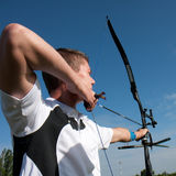 Archer aiming with his bow. Royalty Free Stock Images