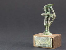 Archer bronze figurine, arrow and bow statuette Stock Photos