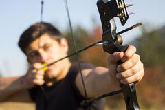 Archer drawing his compound bow Stock Photos