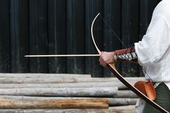 Archer getting ready. Medieval Archer getting ready to shoot arrow at target Royalty Free Stock Image