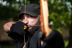 Archer Holds His Bow Aiming At A Target Royalty Free Stock Photography
