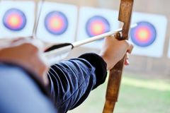 Archer holds his bow aiming at a target Stock Photography