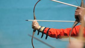 Archer shoots with an arrow. Background the sky stock footage