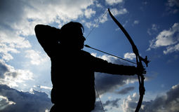 Archer Silhouette. Silhouettes of archer aiming . Beautiful scene Royalty Free Stock Photos