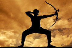 Archer Silhouette. Silhouettes of archer aiming . Beautiful scene Stock Photos