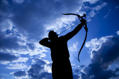 Archer Silhouette. Silhouettes of archer aiming . Beautiful scene Stock Photography