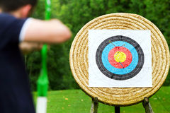 Archer taking aim at target Royalty Free Stock Images
