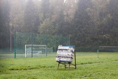 Archer target alone on green field. Royalty Free Stock Image