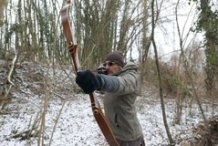 Archer in winter forest Stock Photos