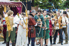Archers. PONTEVEDRA, SPAIN - SEPTEMBER 6, 2014: Some archers try their aim on a target, dressed in costumes of the Middle Ages, in medieval festival held each Stock Photo