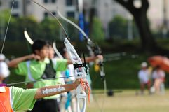 Archers shooting. A row of archers taking aim at their target Royalty Free Stock Photography