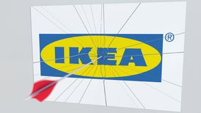 Archery arrow hits plate with IKEA logo. Corporate problems conceptual editorial 3D rendering. Company logo being hit by archery arrow. Business crisis royalty free illustration