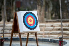 Archery with arrows and holes from previous hits Royalty Free Stock Images