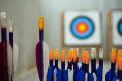Archery arrows with targets in out of focus background Stock Photo