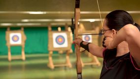 Archery as a sport discipline run in the hall and in the nature. Competition for the best shot an arrow into targets