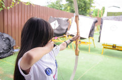 Archery. Asian girl aim target, new player for archery royalty free stock photography