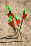 Archery bow arrows closeup on sand Stock Photos