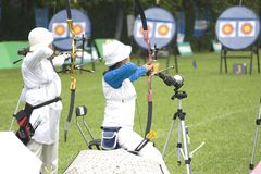 Archery for Disabled Persons. Participants in an archery competition for disabled persons stock image
