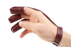 Archery shooting glove on hand Stock Image